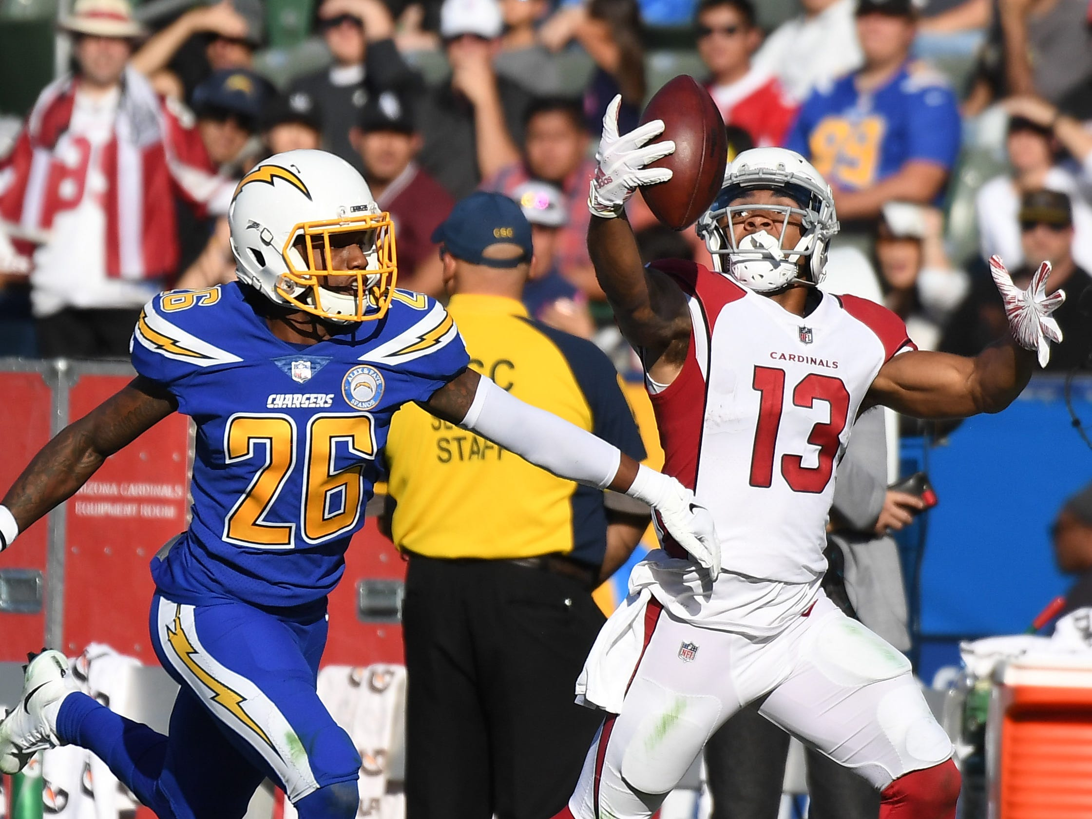 Nov 25, 2018; Carson, CA, USA; Arizona Cardinals wide receiver Christian Kirk (13) cannot catch a pass while defended by Los Angeles Chargers cornerback Casey Hayward (26) in the first half at the StubHub Center. Mandatory Credit: Richard Mackson-USA TODAY Sports