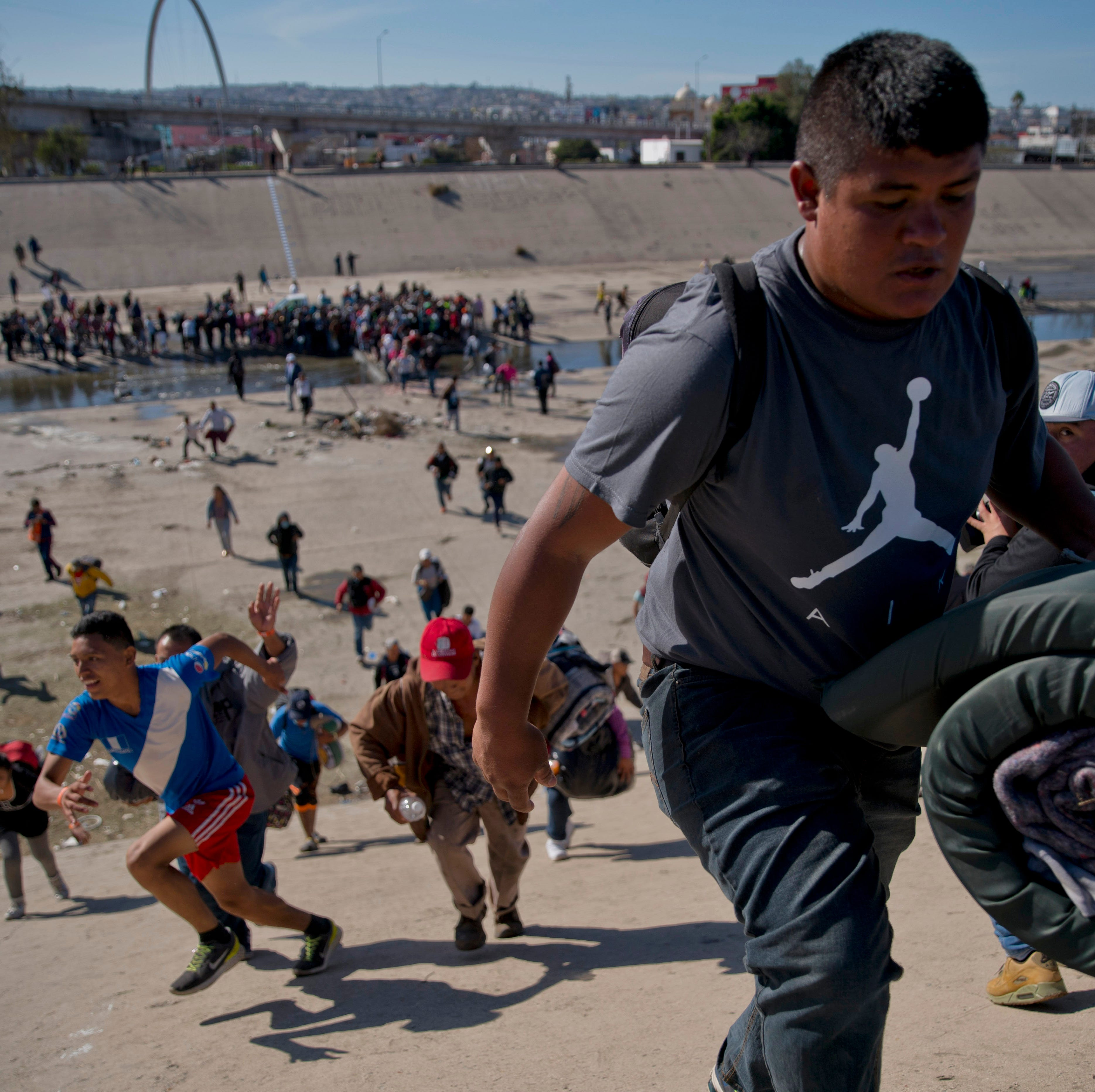 Why do migrant caravans from Central America travel to Tijuana, taking the longest route to the U.S. border?