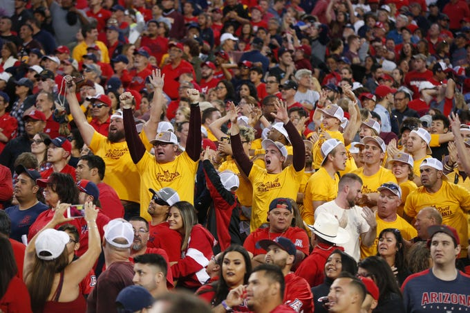 Arizona State Sun Devils fans celebrate after Arizona Wildcats kicker missed the field goal during the Territorial Cup football game at Arizona Stadium in Tucson on November 24.