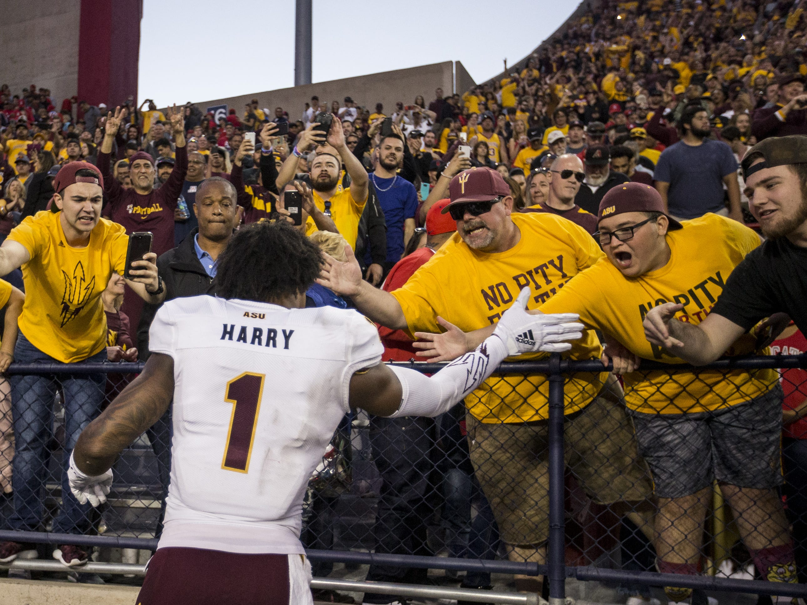 Arizona State's N'Keal Harry celebrates with fans after defeating Arizona for the Territorial Cup on Saturday, Nov. 24, 2018, at Arizona Stadium in Tucson, Ariz. Arizona State won, 41-40.