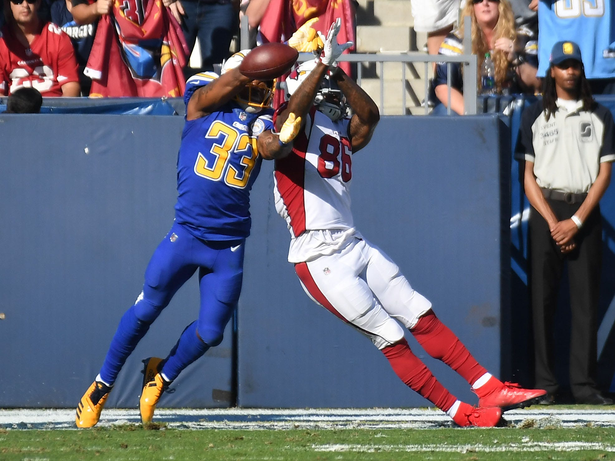 Nov 25, 2018; Carson, CA, USA; Los Angeles Chargers free safety Derwin James (33) breaks up a pass intended for Arizona Cardinals tight end Ricky Seals-Jones (86) in the first half at the StubHub Center. Mandatory Credit: Richard Mackson-USA TODAY Sports