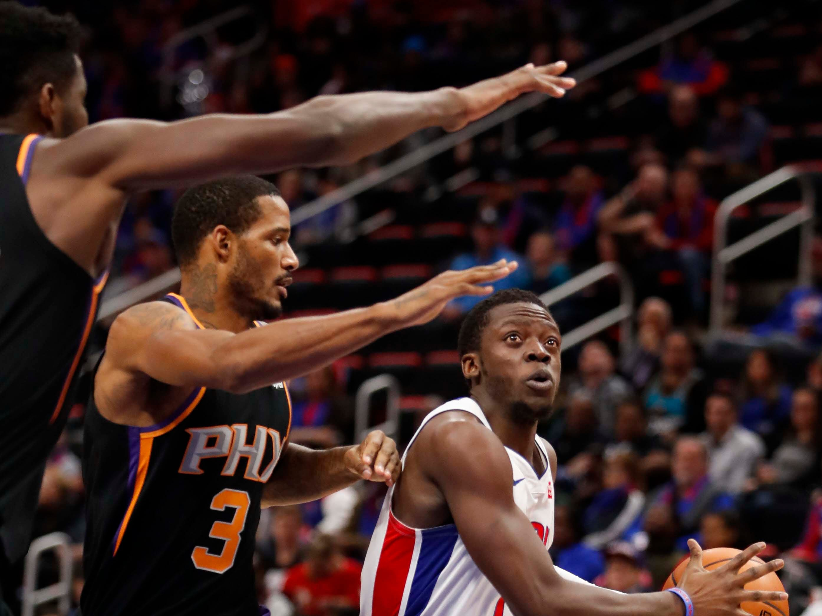 Nov 25, 2018; Detroit, MI, USA; Detroit Pistons guard Reggie Jackson (1) gets defended by Phoenix Suns forward Trevor Ariza (3) during the second quarter at Little Caesars Arena. Mandatory Credit: Raj Mehta-USA TODAY Sports