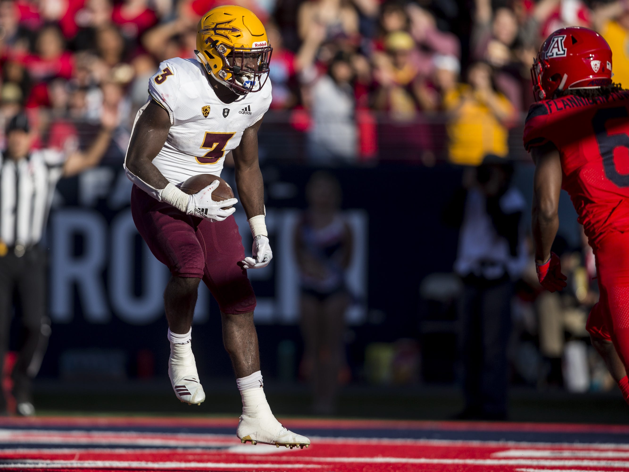 Arizona State's Eno Benjamin celebrates after rushing for a touchdown against Arizona during the second half of the Territorial Cup on Saturday, Nov. 24, 2018, at Arizona Stadium in Tucson, Ariz. Arizona State won, 41-40.
