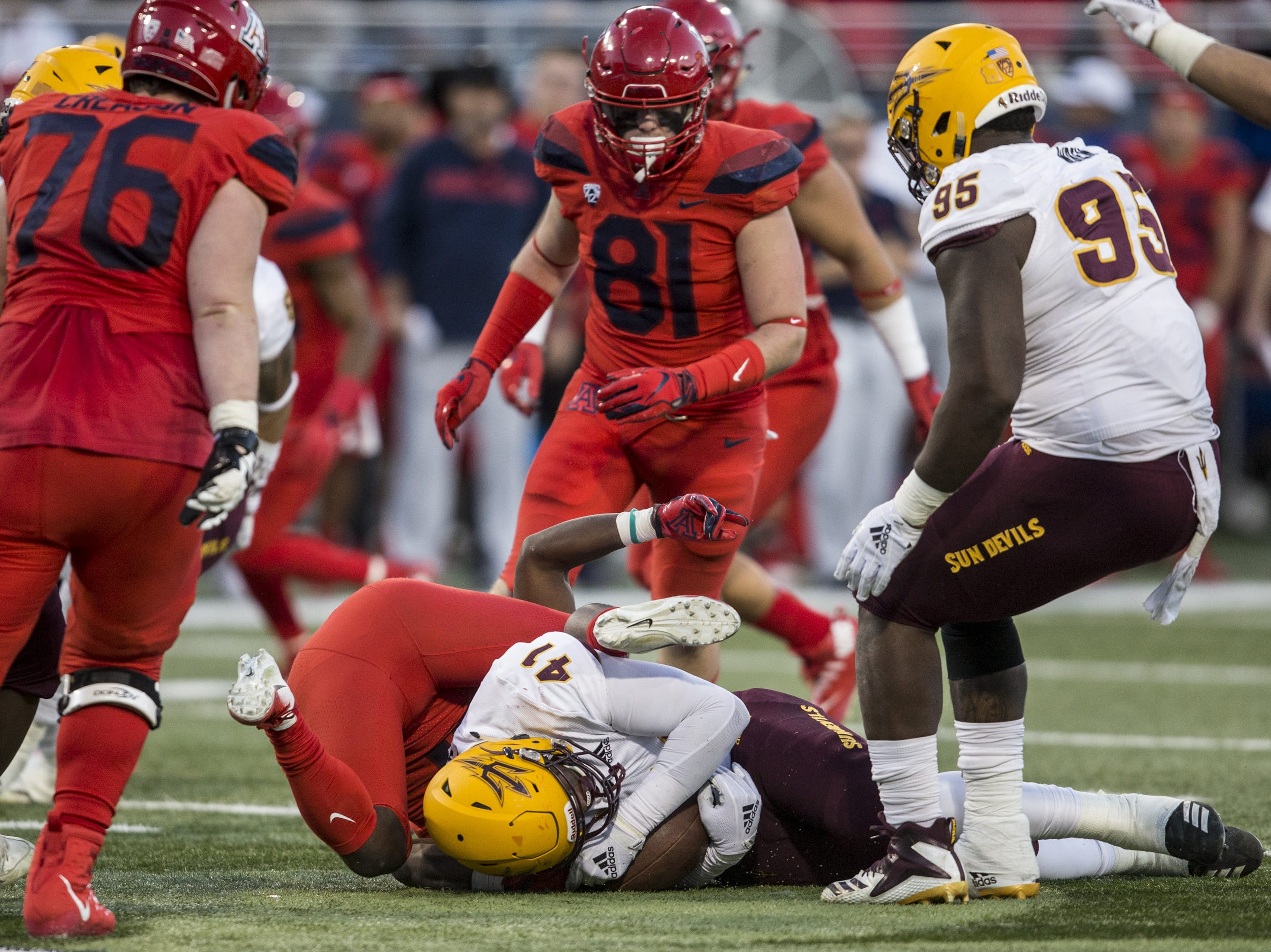 Arizona State's Tyler Johnson recovers a fumble against Arizona during the second half of the Territorial Cup on Saturday, Nov. 24, 2018, at Arizona Stadium in Tucson, Ariz. Arizona State won, 41-40.