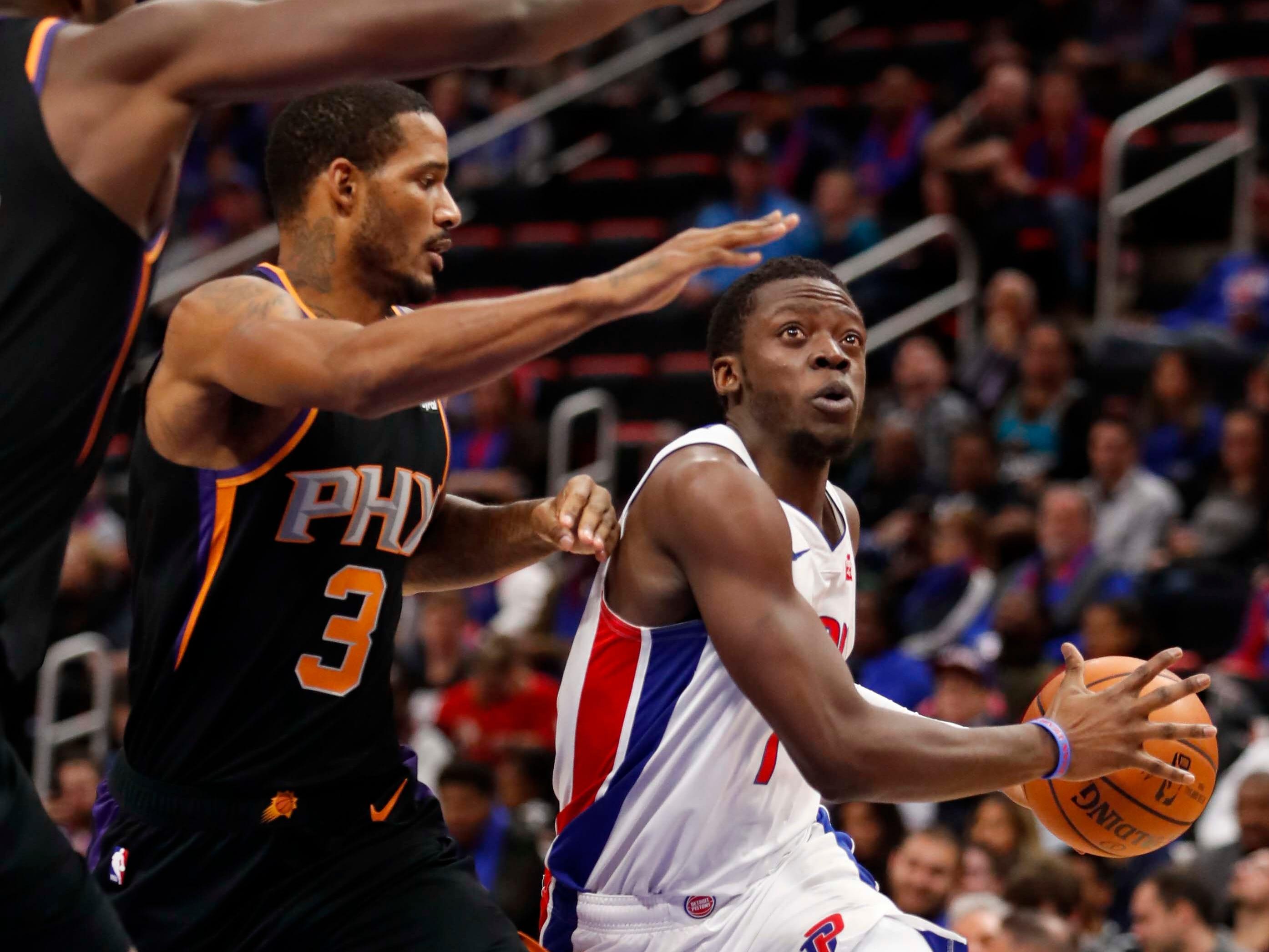 Nov 25, 2018; Detroit, MI, USA; Detroit Pistons guard Reggie Jackson (1) gets defended by Phoenix Suns forward Trevor Ariza (3) during the second quarter at Little Caesars Arena. Mandatory Credit: Raj Mehta-USA TODAY Sports