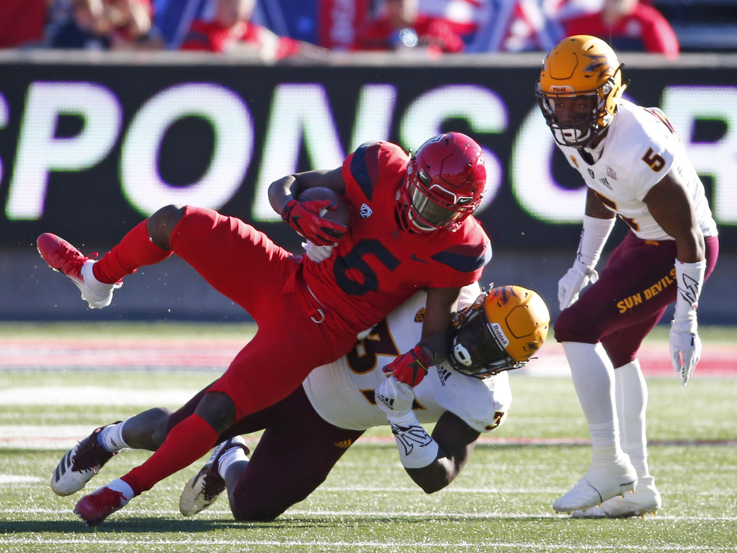 Arizona State Sun Devils linebacker Darien Butler (37) tackles Arizona Wildcats wide receiver Shun Brown (6) during the Territorial Cup football game at Arizona Stadium in Tucson on November 24.