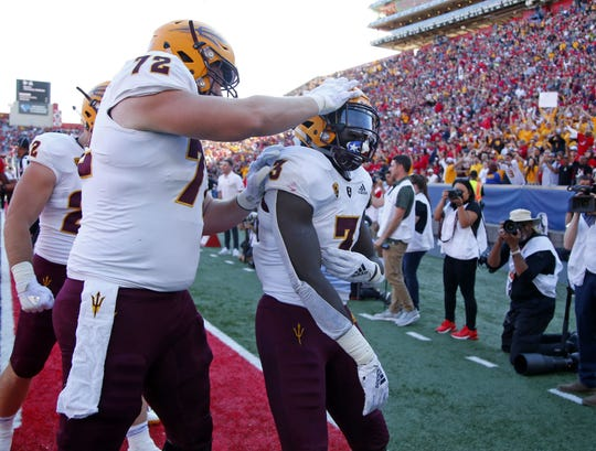 Arizona State Sun Devils offensive lineman Cade Cote (72) congratulates Arizona State Sun Devils running back Eno Benjamin (3) on his touchdown during the Territorial Cup football game against the Arizona Wildcats at Arizona Stadium in Tucson on November 24.