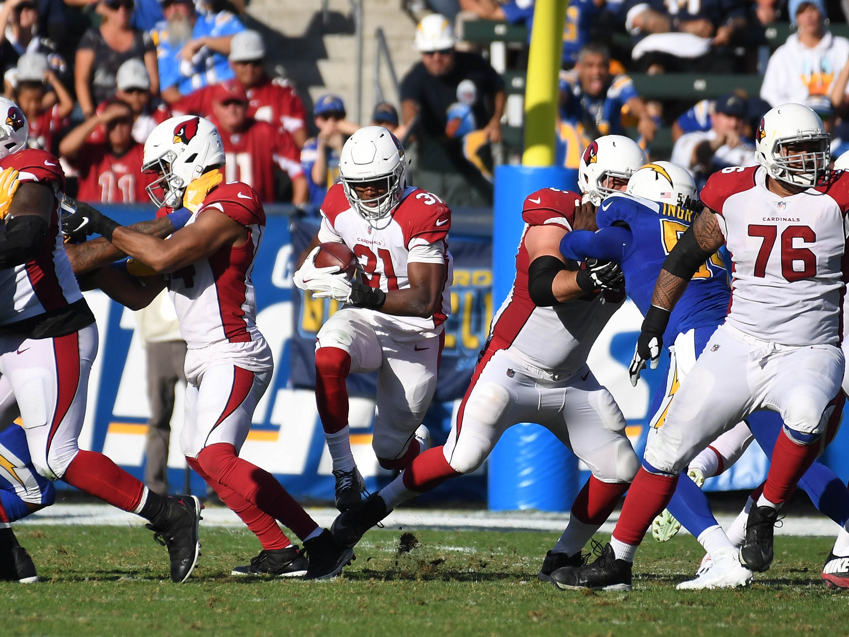 Nov 25, 2018; Carson, CA, USA;  Arizona Cardinals running back David Johnson (31) runs the ball against the Los Angeles Chargers in the first half at the StubHub Center. Mandatory Credit: Richard Mackson-USA TODAY Sports
