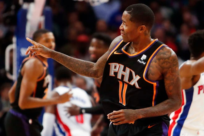 Suns guard Jamal Crawford points to his bench after hitting a shot during the second quarter of a game against the Pistons at Little Caesars Arena.