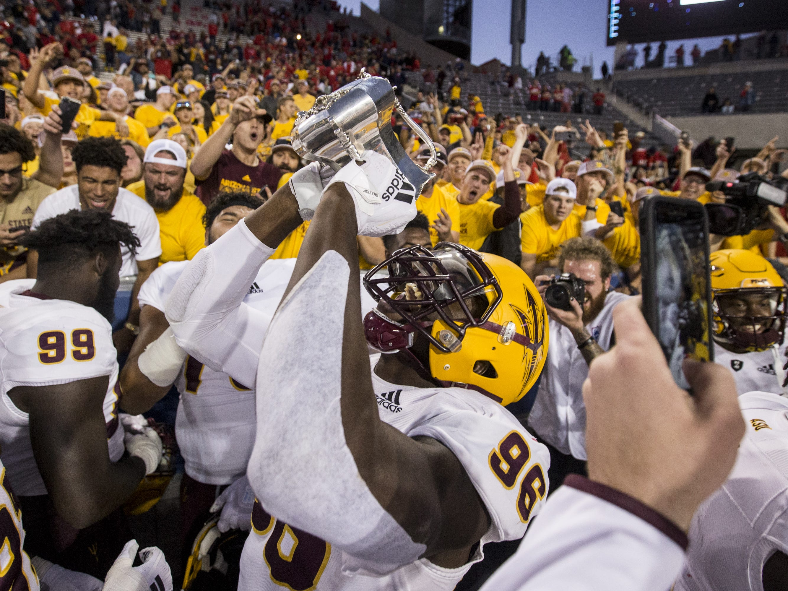 Arizona State's Jalen Bates celebrates after defeating Arizona for the Territorial Cup on Saturday, Nov. 24, 2018, at Arizona Stadium in Tucson, Ariz. Arizona State won, 41-40.