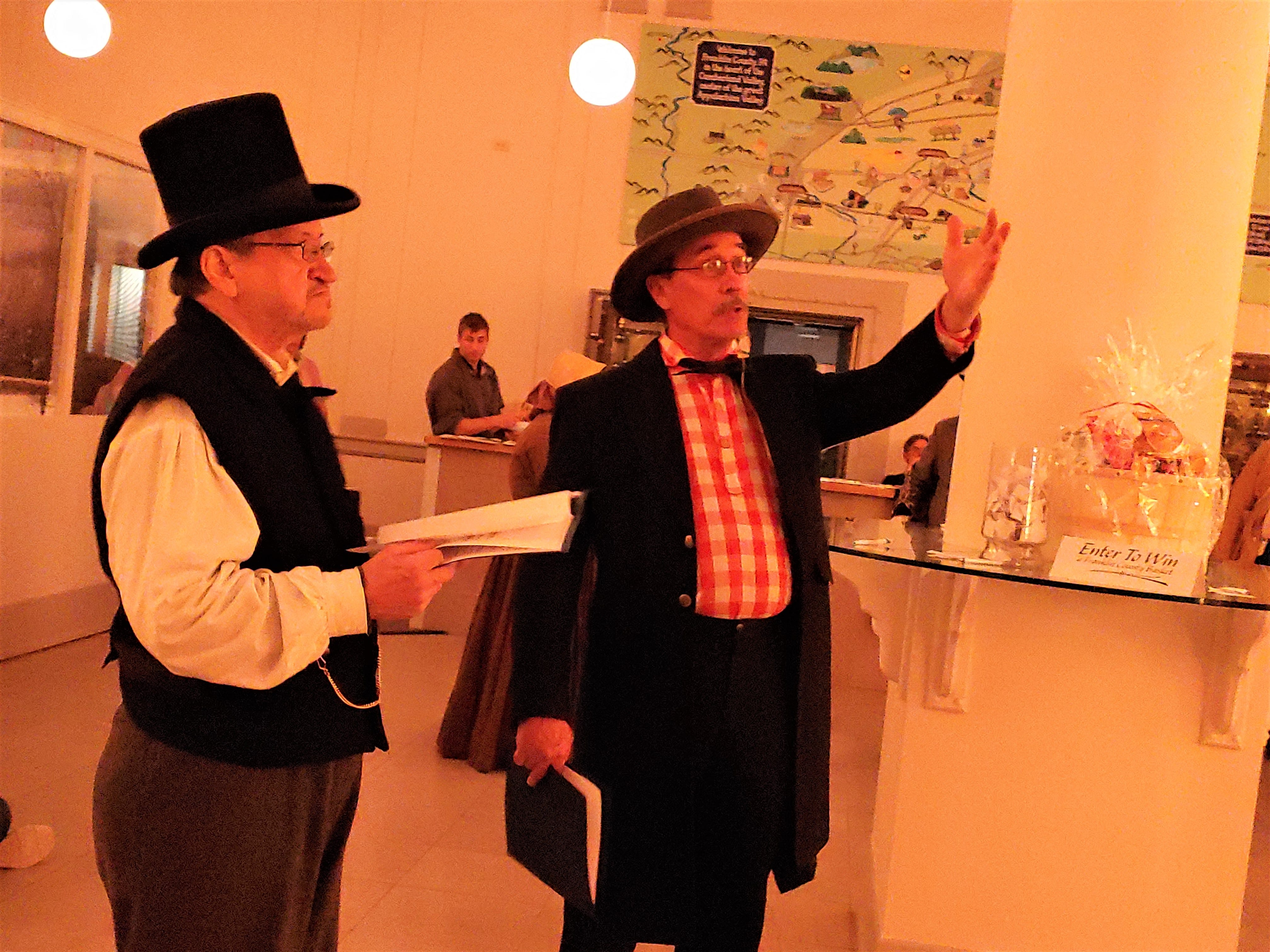 """John Shindledecker, playing Mr. Sharpe, and Charles Rittenhouse, playing Jacob Hoke, talk about Chambersburg, which will soon be burned to the ground by the Confederates. Franklin County Visitors Bureau presented """"300 Year's of America's History,"""" including the 1864 Ransoming, Burning and Rebirth of Chambersburg, during the grand opening of the 11/30 Welcome Center on Saturday, Nov. 24, 2018. Featured were Andy Newman, Bryton Zook, Carlos Lee, Charles Rittenhouse, David Moore, Dawn Snider, Emily Martin, John Shindledecker, Nancy Godfrey and Susan Wall."""