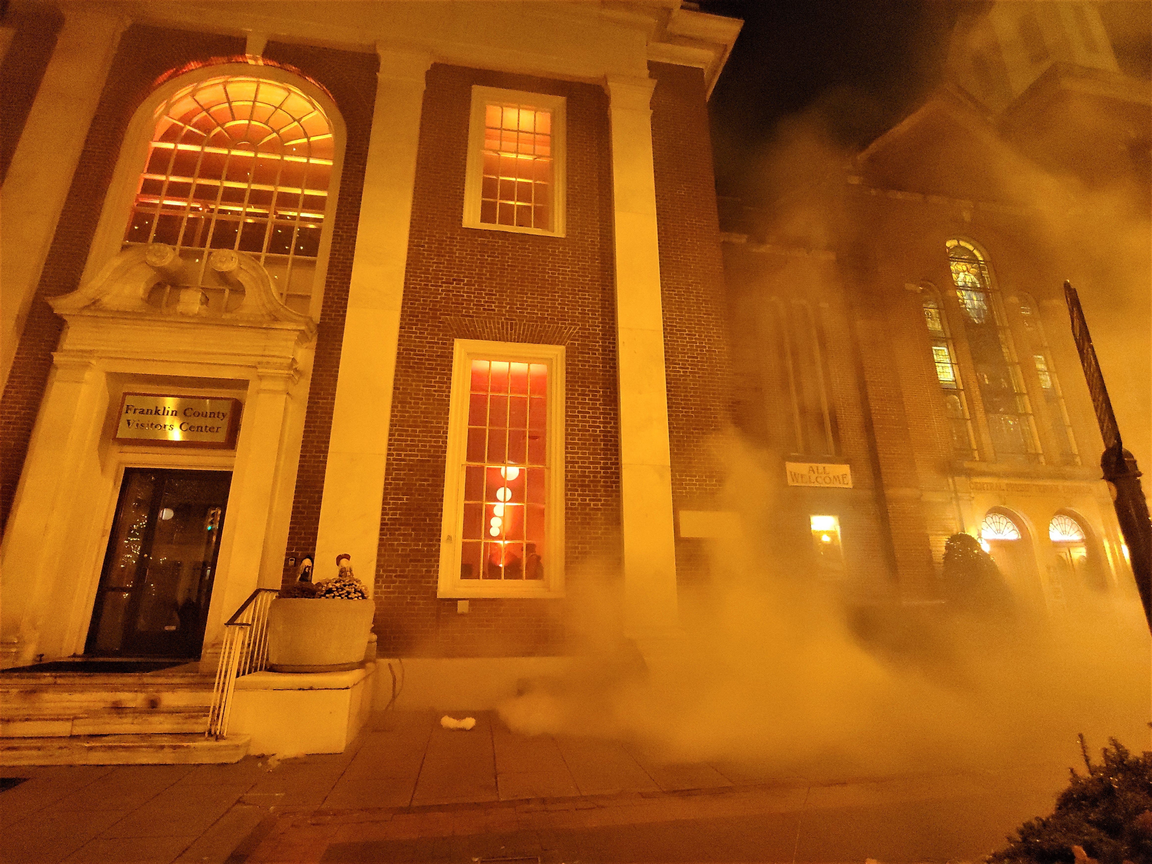 """Smoke billows outside the 11/30 Welcome Center and Franklin County Visitors Bureau during a reenaction of the burning of Chambersburg. Franklin County Visitors Bureau presented """"300 Year's of America's History,"""" including the 1864 Ransoming, Burning and Rebirth of Chambersburg, during the grand opening of the 11/30 Welcome Center on Saturday, Nov. 24, 2018. Featured were Andy Newman, Bryton Zook, Carlos Lee, Charles Rittenhouse, David Moore, Dawn Snider, Emily Martin, John Shindledecker, Nancy Godfrey and Susan Wall."""