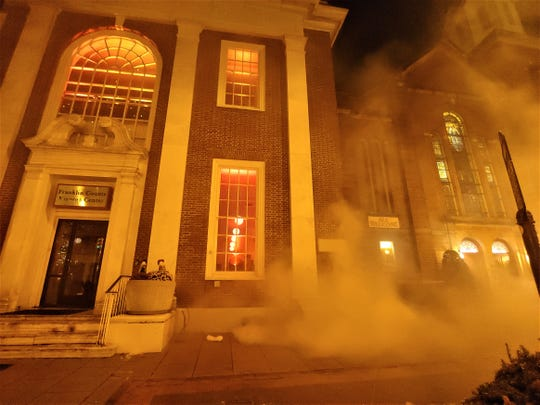 "Smoke billows outside the 11/30 Welcome Center and Franklin County Visitors Bureau during a reenaction of the burning of Chambersburg. Franklin County Visitors Bureau presented ""300 Year's of America's History,"" including the 1864 Ransoming, Burning and Rebirth of Chambersburg, during the grand opening of the 11/30 Welcome Center on Saturday, Nov. 24, 2018. Featured were Andy Newman, Bryton Zook, Carlos Lee, Charles Rittenhouse, David Moore, Dawn Snider, Emily Martin, John Shindledecker, Nancy Godfrey and Susan Wall."