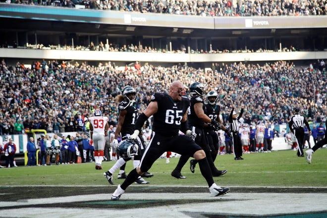 Philadelphia Eagles' Lane Johnson (65) celebrates a touchdown during the second half of an NFL football game against the New York Giants, Sunday, Nov. 25, 2018, in Philadelphia. (AP Photo/Michael Perez)