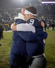 Penn State coach James Franklin, left, and quarterback Trace McSorley embrace after finishing a television interview after the team's win over Maryland in an NCAA college football game Saturday, Nov. 24, 2018, in State College, Pa. (Abby Drey/Centre Daily Times via AP)