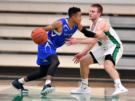 Matthew Tate of F&M College, is covered by York College's Jared Wagner, Sunday, November 25, 2018. John A. Pavoncello photo