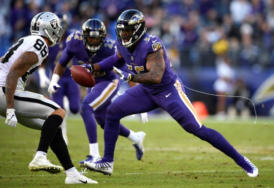 Baltimore Ravens outside linebacker Terrell Suggs, right, rushes past Oakland Raiders wide receiver Marcell Ateman (88) for a touchdown after recovering a fumble in the second half of an NFL football game, Sunday, Nov. 25, 2018, in Baltimore. (AP Photo/Nick Wass)