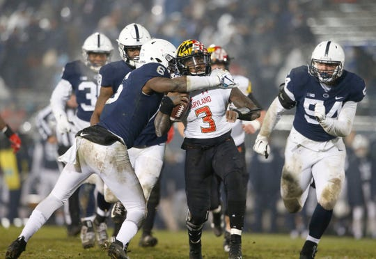 Penn State's Cam Brown (6) tackles Maryland quarterback Tyrrell Pigrome (3) during the second half of an NCAA college football game in State College, Pa., Saturday, Nov. 24, 2018. Penn State won 38-3.