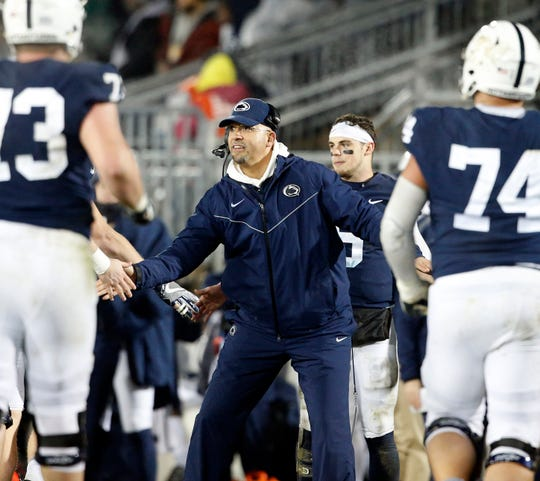 Penn State head coach James Franklin, congratulates his players after a touchdown against Maryland during the second half of an NCAA college football game in State College, Pa., Saturday, Nov. 24, 2018. Penn State won 38-3.