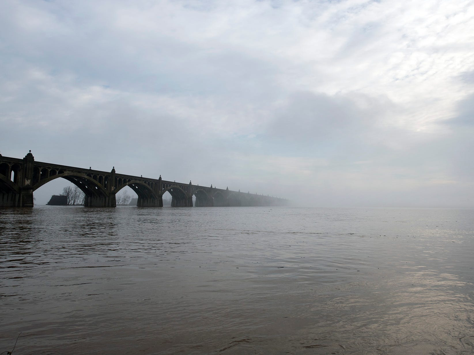 Veterans Memorial Bridge disappears into the fog as if heads into Columbia from Wrightsville on Sunday November 25, 2018.