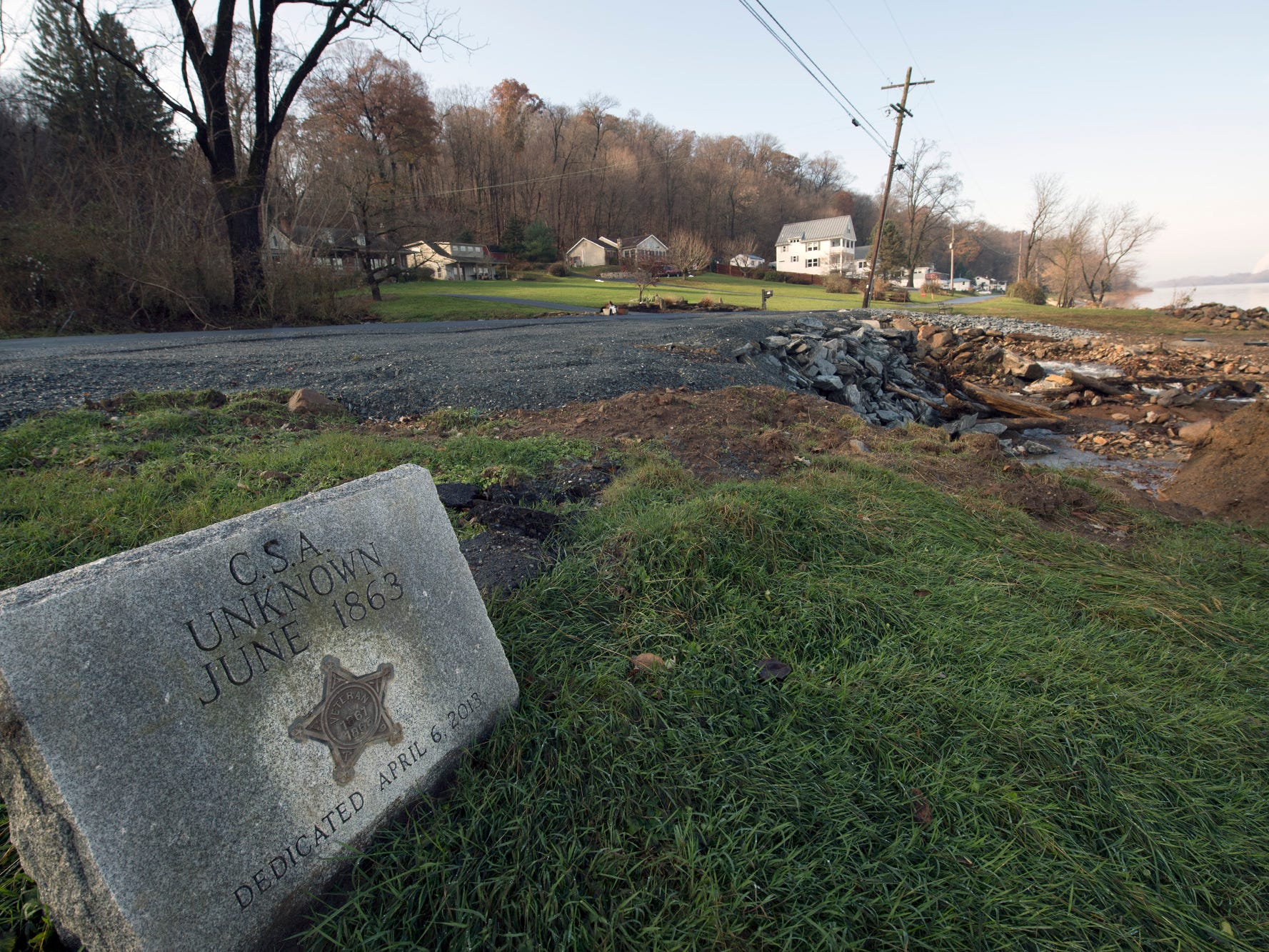 A Civil War marker is back in place near repaired washed out bridge on River Drive in Hellam Township Sunday November 25, 2018.