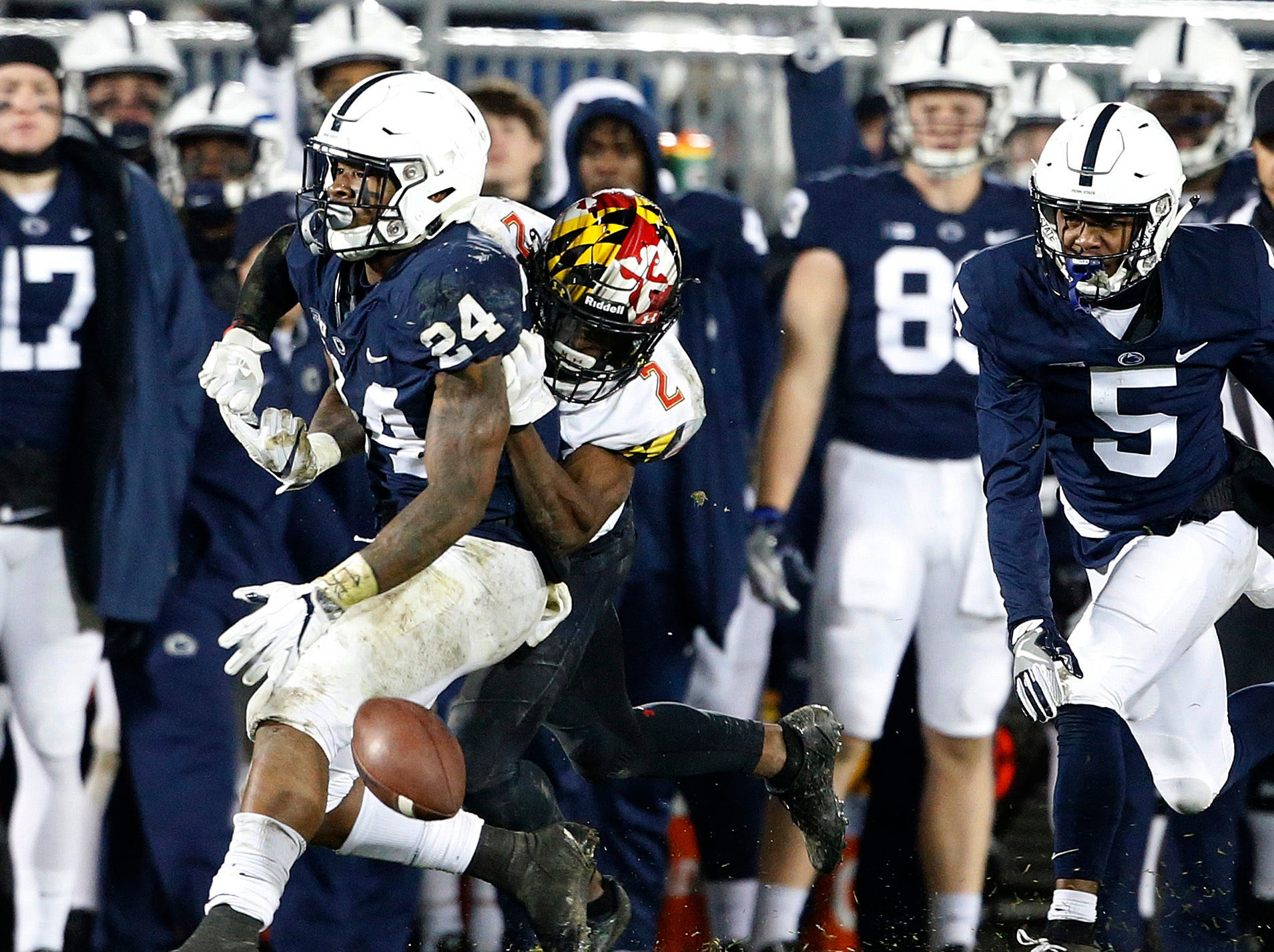 Maryland's RaVon Davis (2) strips the ball from Penn State's Miles Sanders (24) during the second half of an NCAA college football game in State College, Pa., Saturday, Nov. 24, 2018. Penn State won 38-3.
