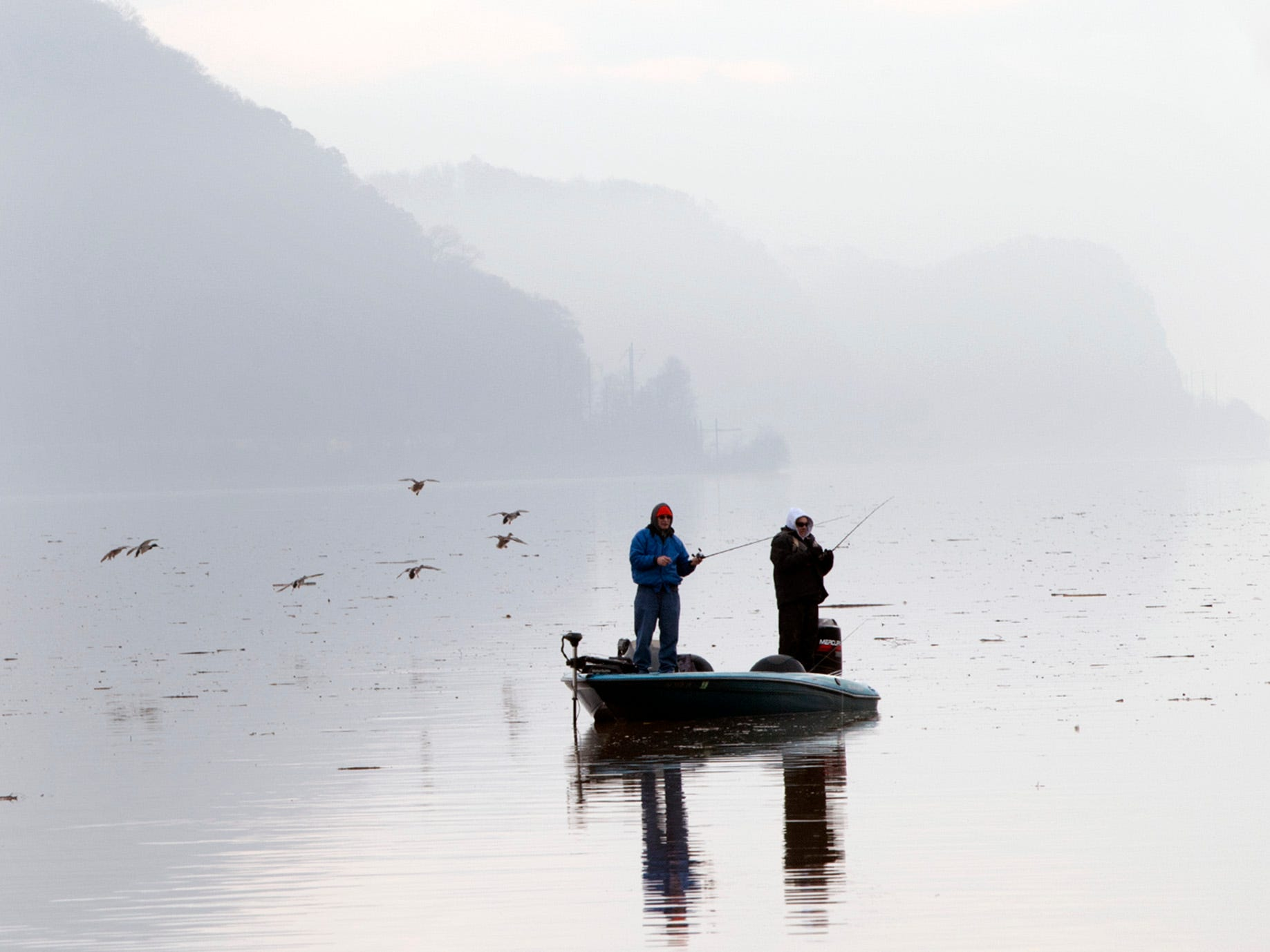 Fisherman wait for a catch on still water in the fog off of Long Level in Lower Windsor Township on Sunday November 25, 2018.
