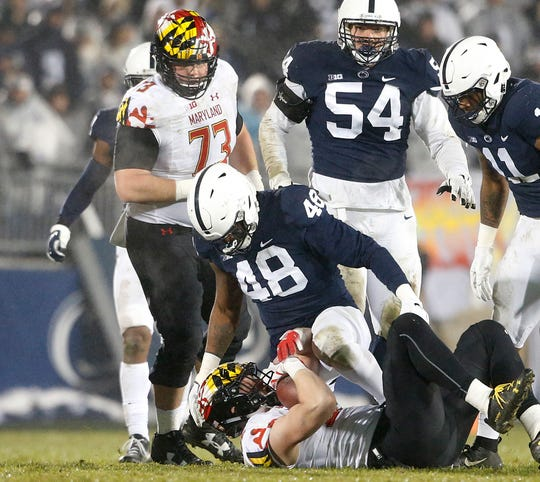 Penn State's Shareef Miller (48) drops Maryland's Avery Edwatds (82) for a loss during the second half of an NCAA college football game in State College, Pa., Saturday, Nov. 24, 2018. Penn State won 38-3.