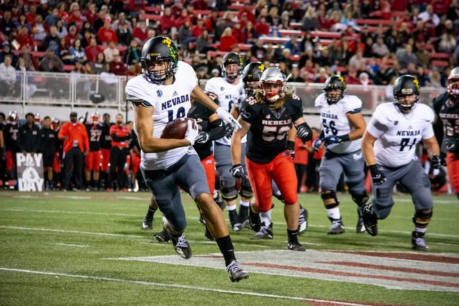 Nevada receiver Cole Turner heads toward the end zone during last season's Fremont Cannon game in Las Vegas.
