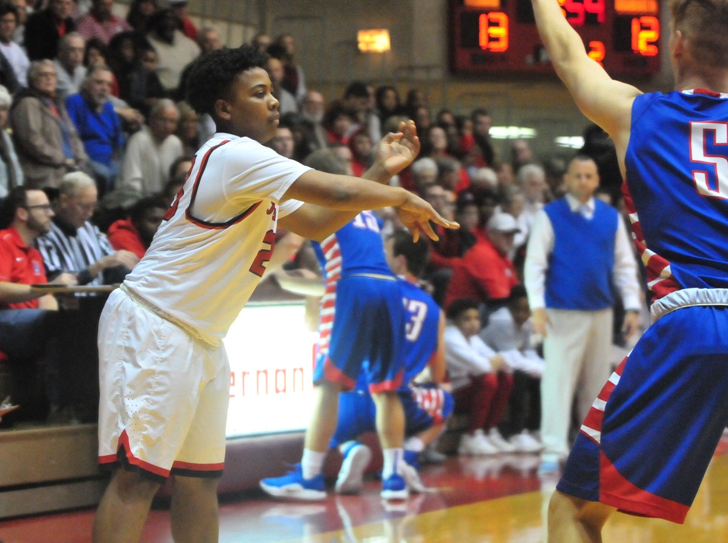 Richmond High School senior Tayjim Deloney (23) makes a pass during a boys basketball game against Jay County Saturday, Nov. 24, 2018 at Richmond High School's Tiernan Center.