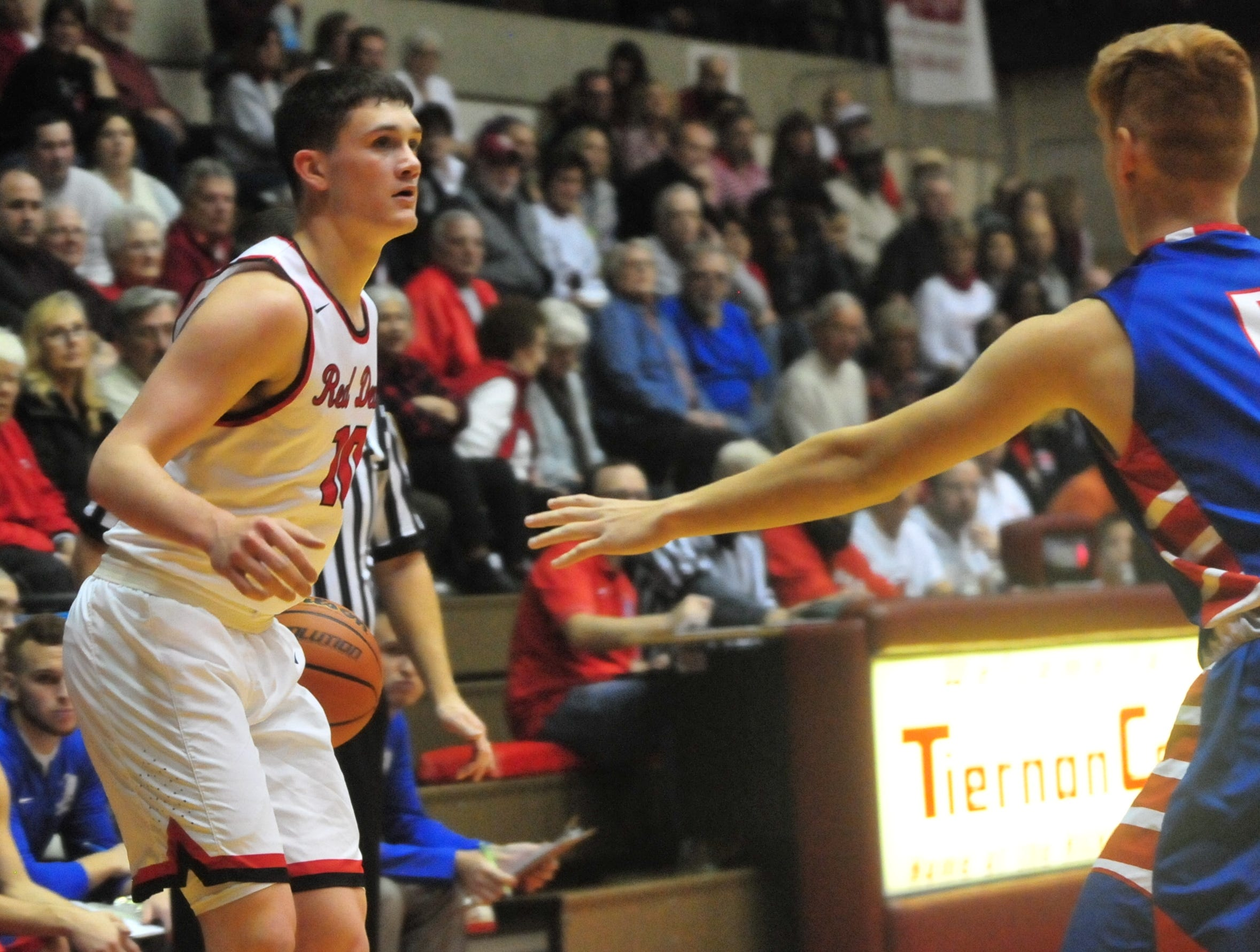 Richmond High School senior Lucas Kroft handles the ball during a boys basketball game against Jay County Saturday, Nov. 24, 2018 at Richmond High School's Tiernan Center.