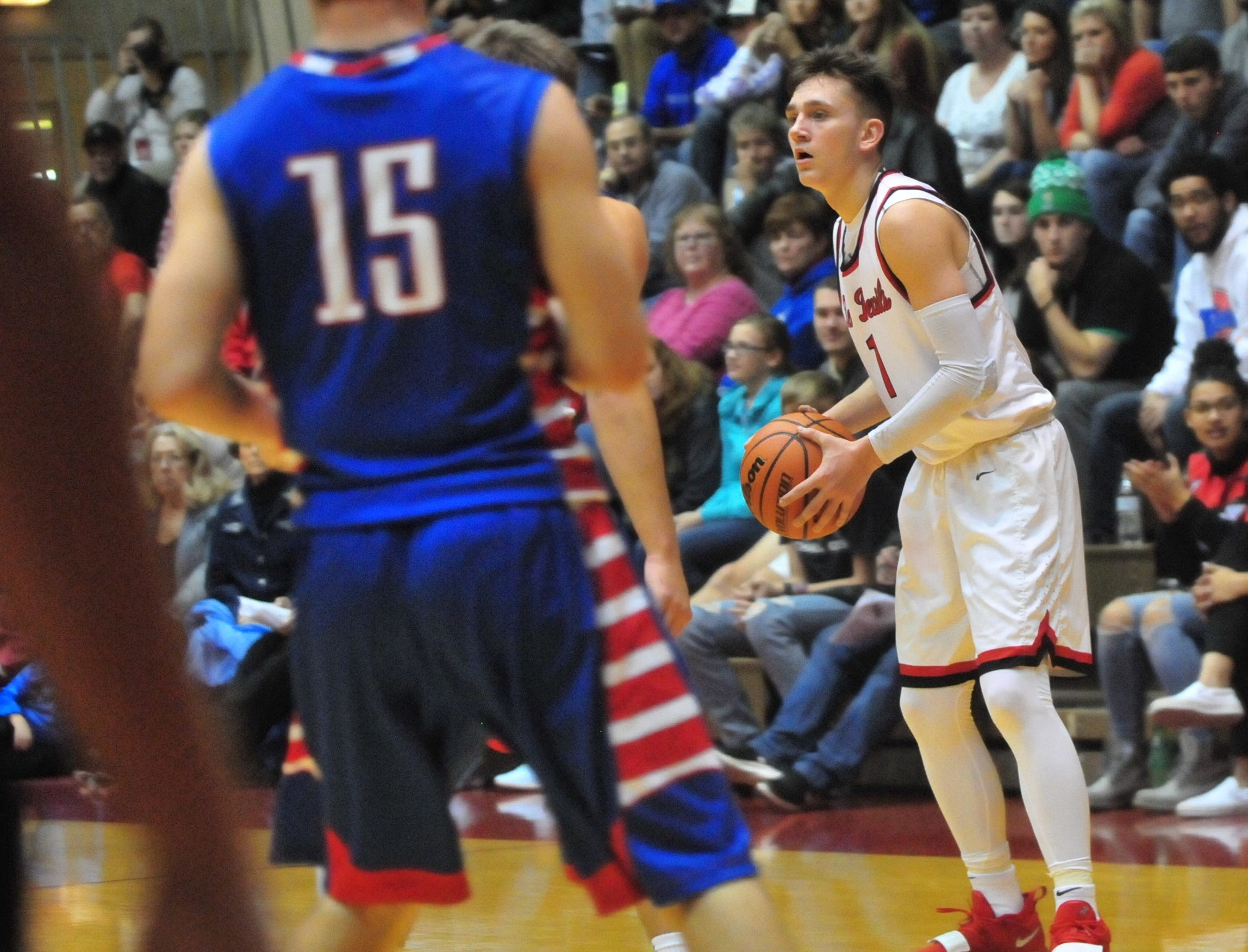 Richmond High School sophomore Andrew Kroft (1) during a boys basketball game against Jay County Saturday, Nov. 24, 2018 at Richmond High School's Tiernan Center.