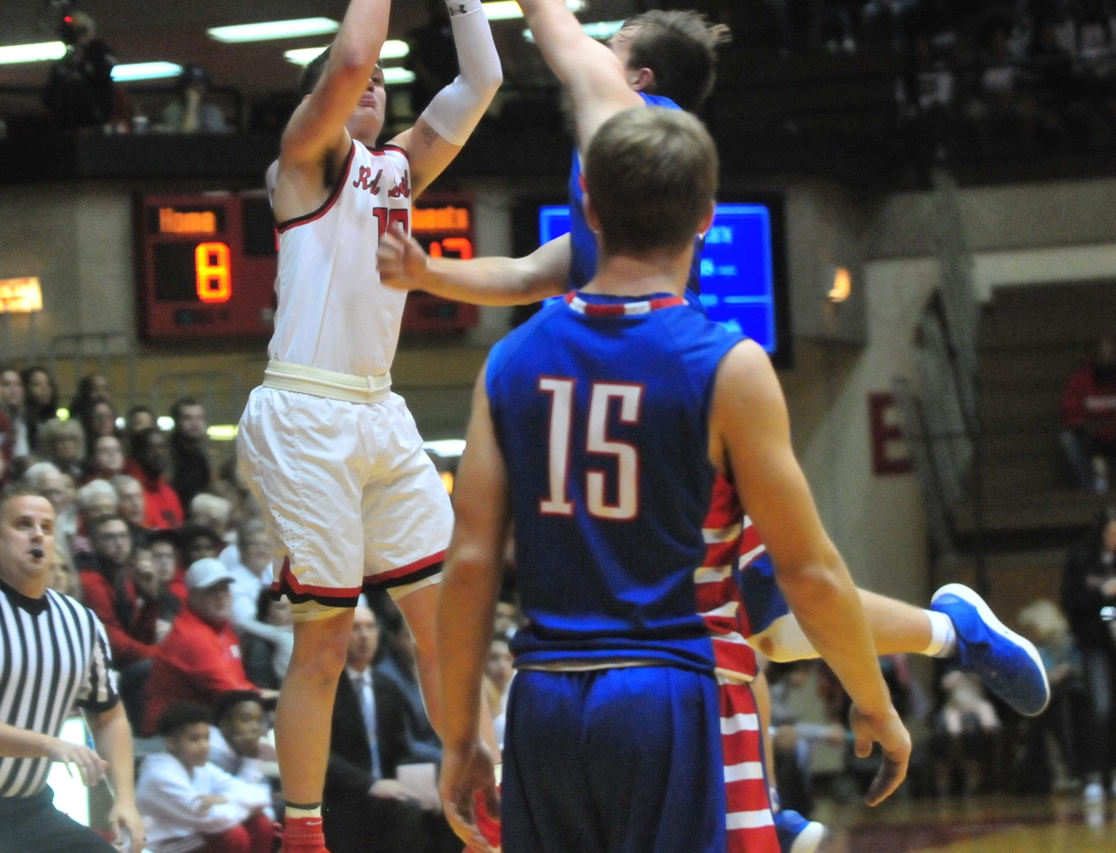 Richmond High School senior Lucas Kroft shoots a 3-pointer at the end of the first quarter during a boys basketball game against Jay County Saturday, Nov. 24, 2018 at Richmond High School's Tiernan Center.