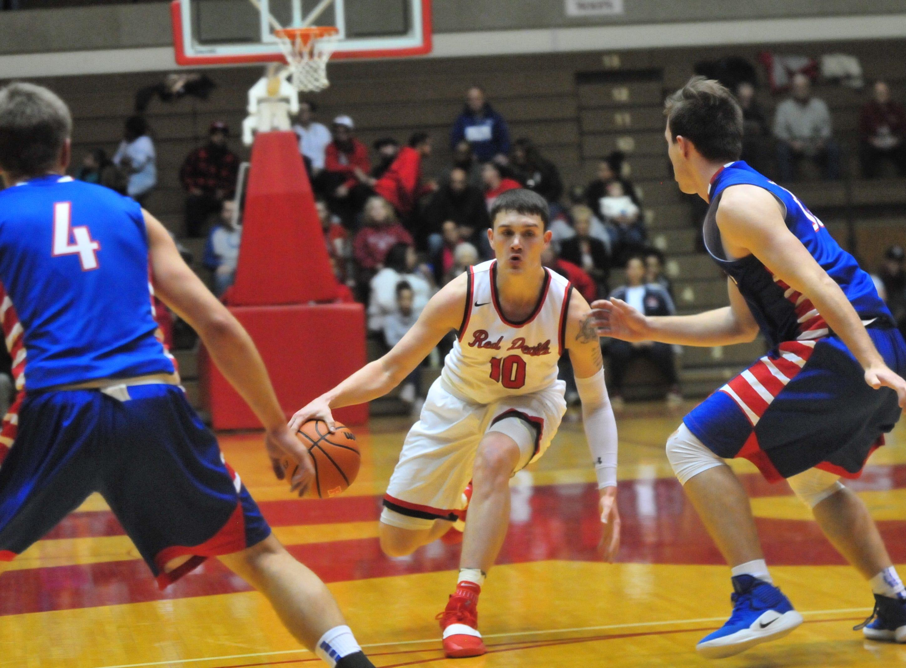 Richmond High School senior Lucas Kroft (10) moves the ball during a boys basketball game against Jay County Saturday, Nov. 24, 2018 at Richmond High School's Tiernan Center.
