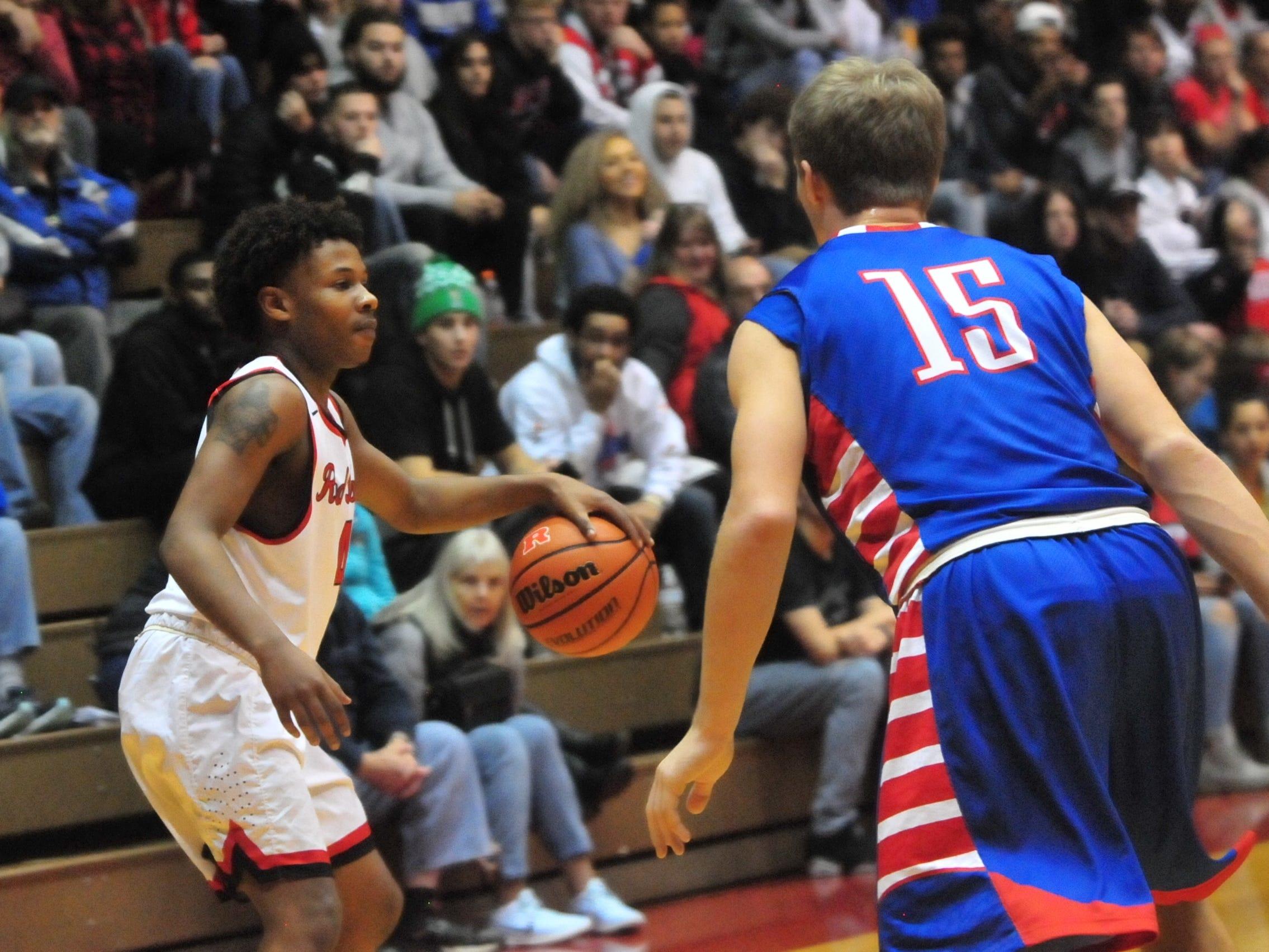 Richmond High School junior Koream Jett (4) moves the ball during a boys basketball game against Jay County Saturday, Nov. 24, 2018 at Richmond High School's Tiernan Center.