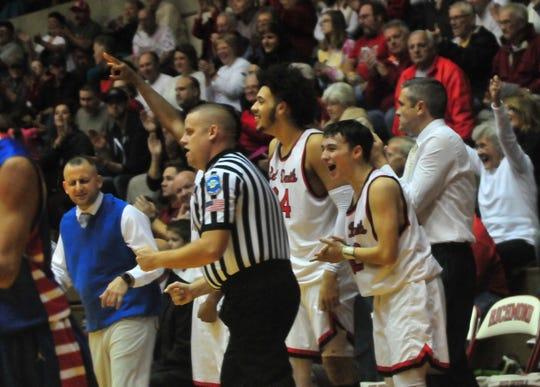Members of Richmond High School's boys basketball team celebrate during a boys basketball game against Jay County Saturday, Nov. 24, 2018 at Richmond High School's Tiernan Center.