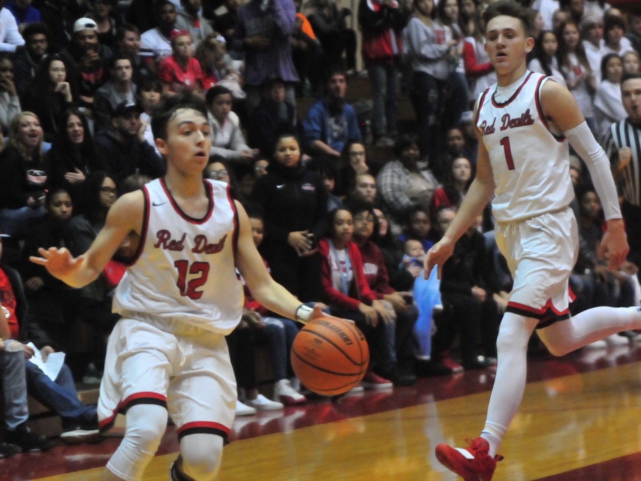 Richmond High School senior Jalen Hillard (12) move the ball  during a boys basketball game against Jay County Saturday, Nov. 24, 2018 at Richmond High School's Tiernan Center.