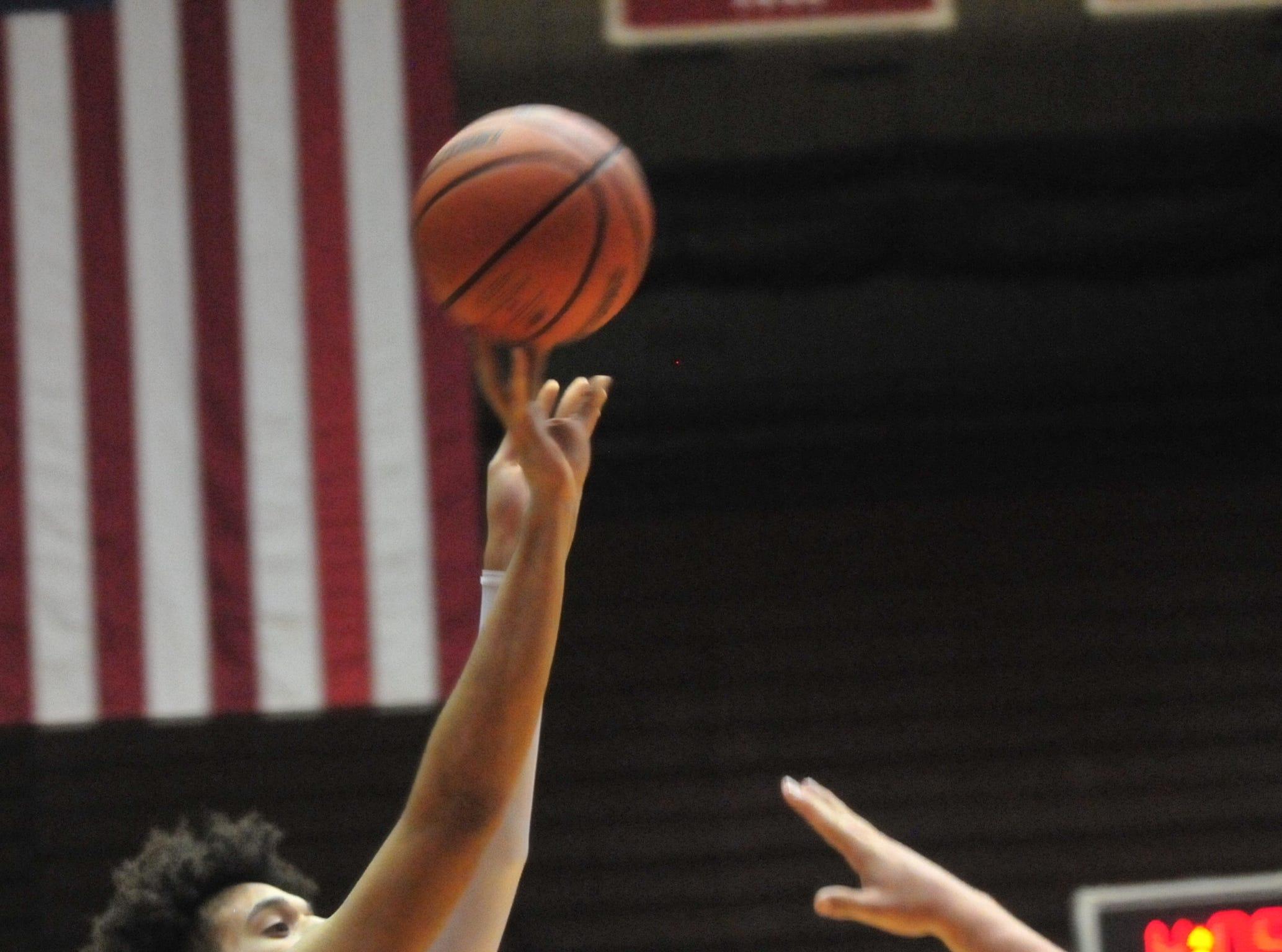 Richmond High School senior Jordan Frye takes a shot during a boys basketball game against Jay County Saturday, Nov. 24, 2018 at Richmond High School's Tiernan Center.