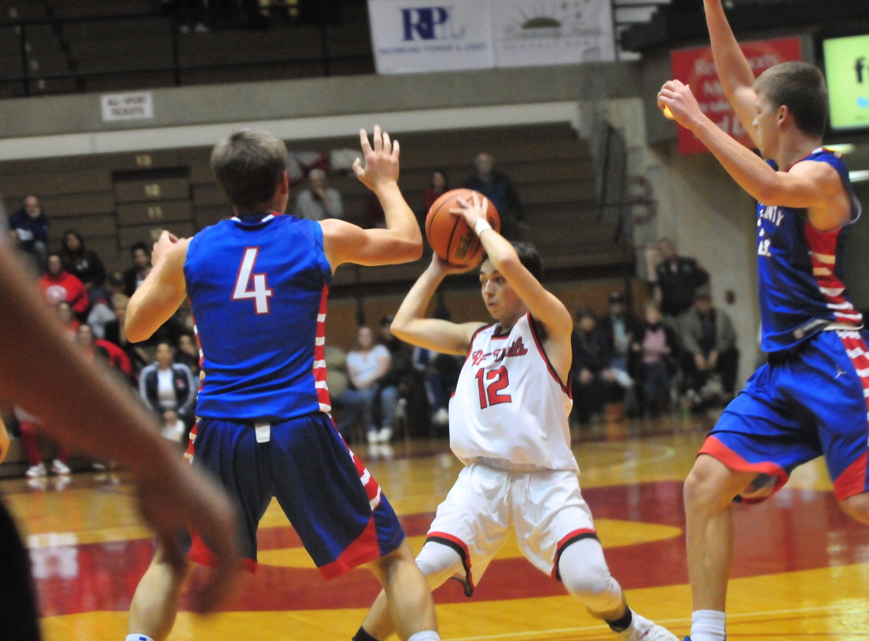 Richmond High School senior Jalen Hillard (12) makes a pass during a boys basketball game against Jay County Saturday, Nov. 24, 2018 at Richmond High School's Tiernan Center.