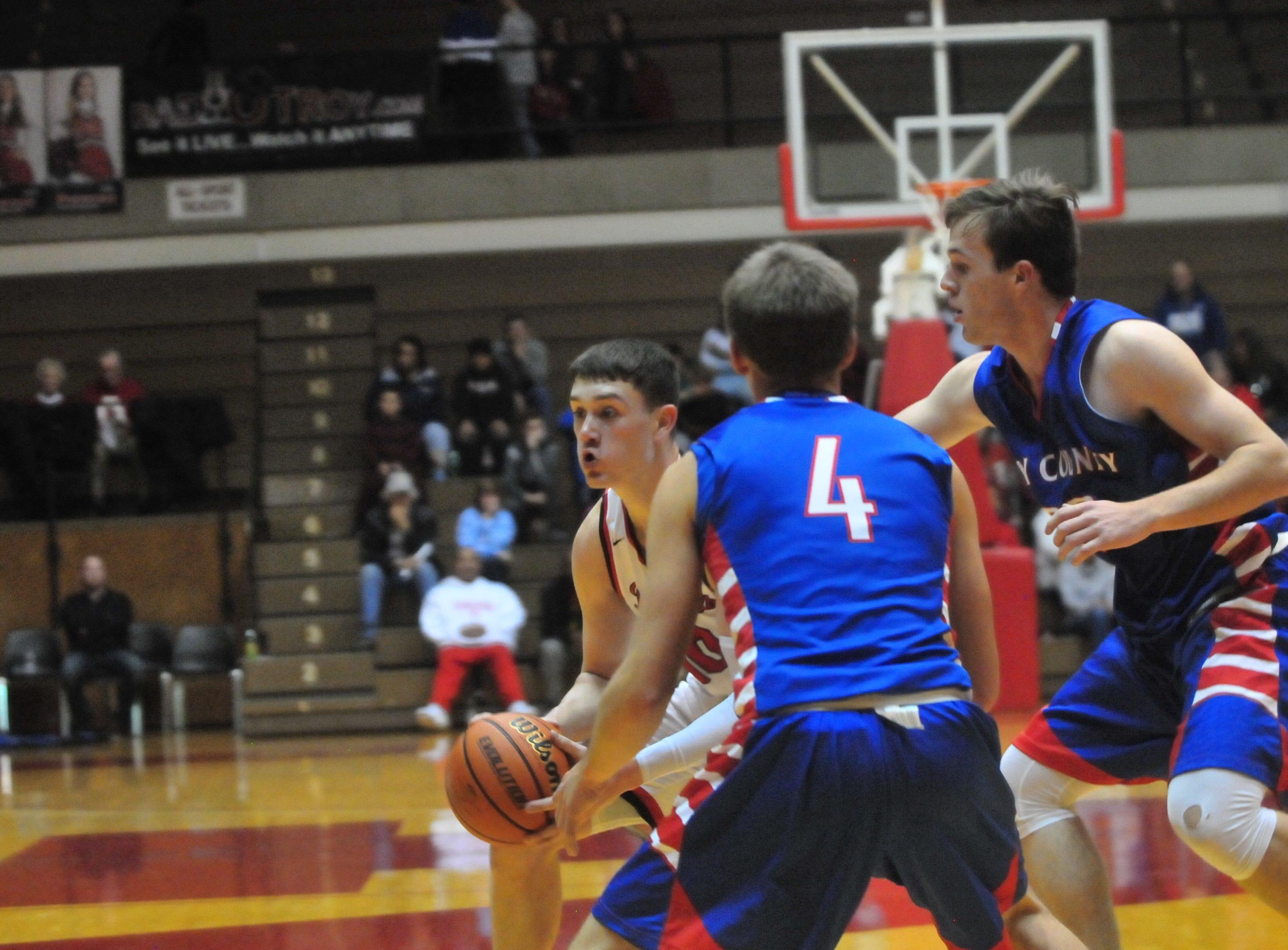 Richmond High School senior Lucas Kroft moves the ball during a boys basketball game against Jay County Saturday, Nov. 24, 2018 at Richmond High School's Tiernan Center.