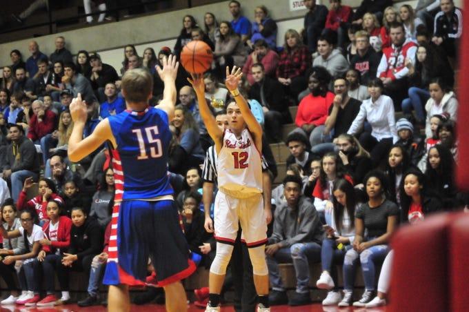 Richmond High School senior Jalen Hillard (12) shoots a 3-pointer during the Red Devils' 70-47 win over Jay County Saturday, Nov. 24, 2018 at Tiernan Center.