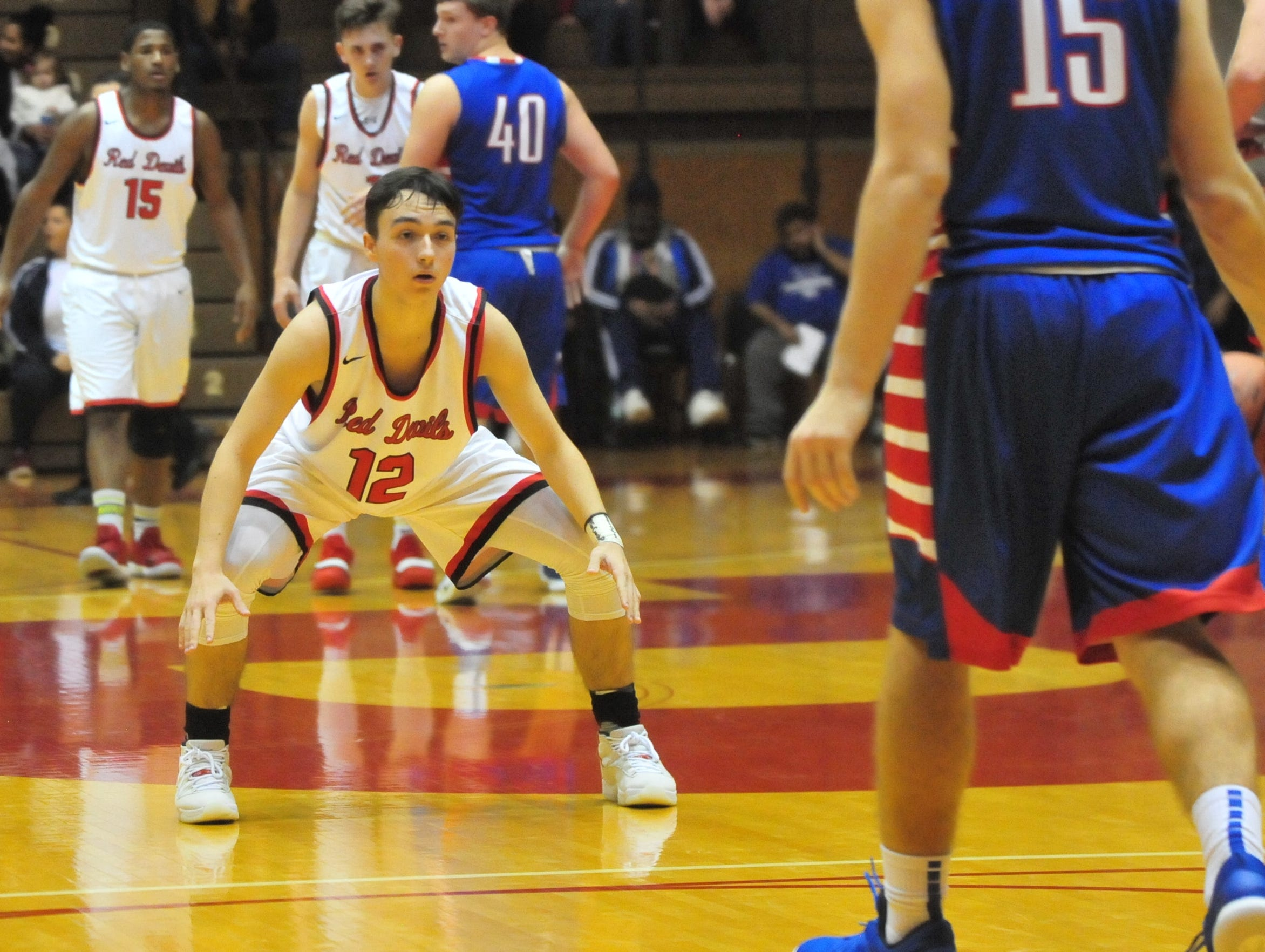 Richmond High School senior Jalen Hillard (12) plays defense during a boys basketball game against Jay County Saturday, Nov. 24, 2018 at Richmond High School's Tiernan Center.