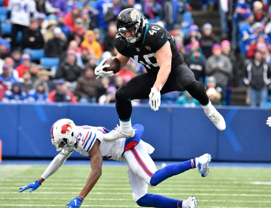 Nov 25, 2018; Orchard Park, NY, USA; Jacksonville Jaguars fullback Tommy Bohanon (40) leaps over Buffalo Bills defensive back Levi Wallace (47) during the second quarter at New Era Field. Mandatory Credit: Mark Konezny-USA TODAY Sports