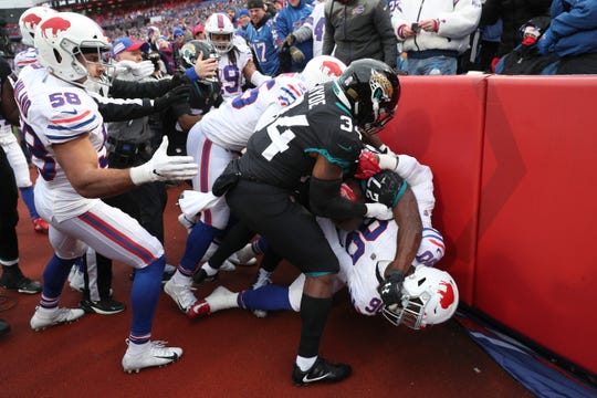 Buffalo Bills defensive end Shaq Lawson fights with Jacksonville's Leonard Fournett during a game on Nov. 25.  Both players were ejected during the fight.