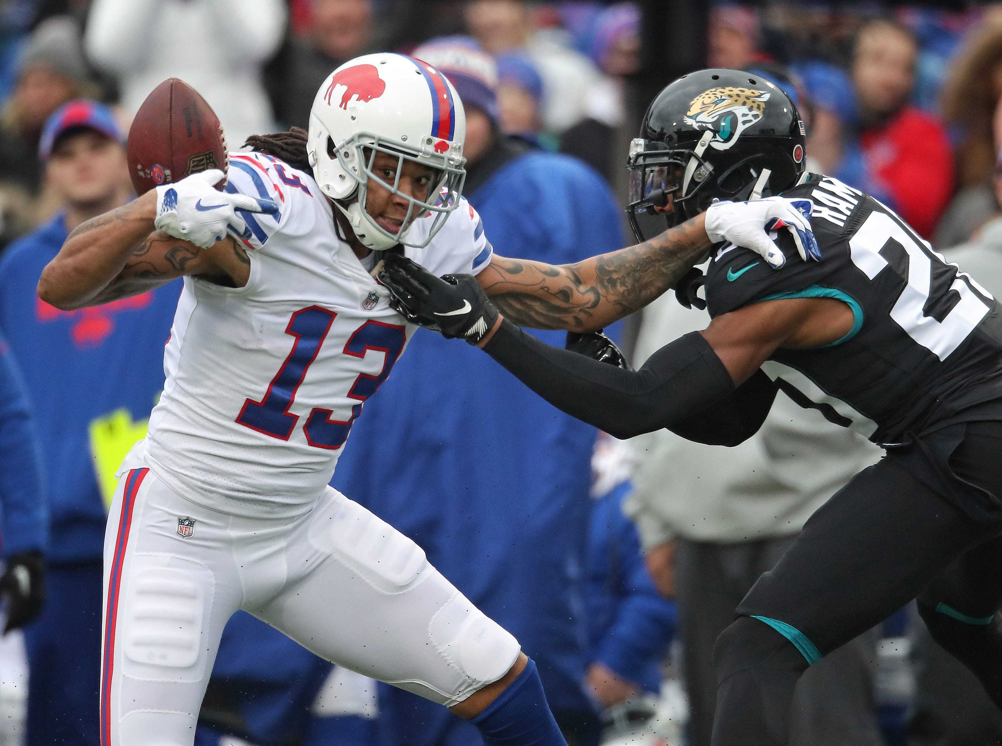 BUFFALO, NY - NOVEMBER 25: Kelvin Benjamin #13 of the Buffalo Bills bobbles a pass but manages to recover and hold on to the ball for the reception in the first quarter during NFL game action against the Jacksonville Jaguars at New Era Field on November 25, 2018 in Buffalo, New York. (Photo by Tom Szczerbowski/Getty Images)