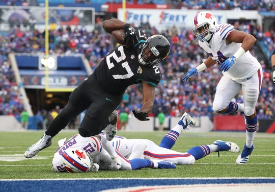 BUFFALO, NY - NOVEMBER 25: Leonard Fournette #27 of the Jacksonville Jaguars is brought down at the one-yard line in the second quarter as he runs with the ball during NFL game action against the Buffalo Bills at New Era Field on November 25, 2018 in Buffalo, New York. (Photo by Tom Szczerbowski/Getty Images)
