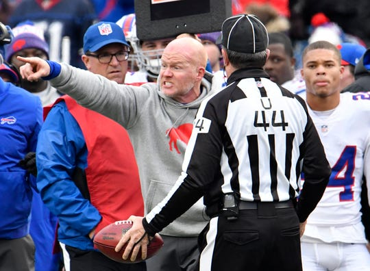 Nov 25, 2018; Orchard Park, NY, USA; Buffalo Bills head coach Sean McDermott argues with umpire Jeff Rice (44) that his player intercepted a pass during the third quarter against the Jacksonville Jaguars at New Era Field. Mandatory Credit: Mark Konezny-USA TODAY Sports
