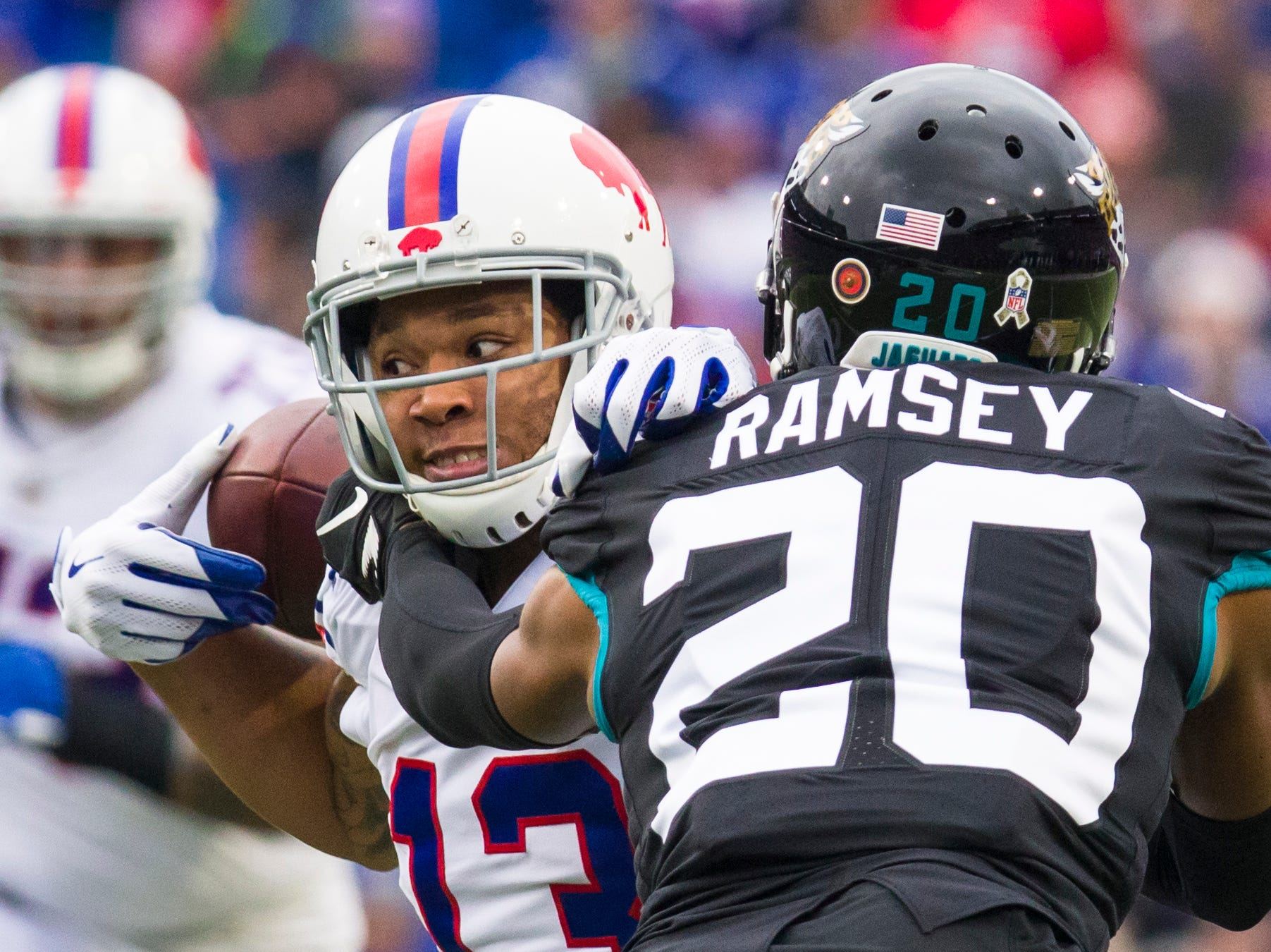 ORCHARD PARK, NY - NOVEMBER 25:  Kelvin Benjamin #13 of the Buffalo Bills fumbles and recovers a pass as Jalen Ramsey #20 of the Jacksonville Jaguars makes contact during the first quarter at New Era Field on November 25, 2018 in Orchard Park, New York.  (Photo by Brett Carlsen/Getty Images)