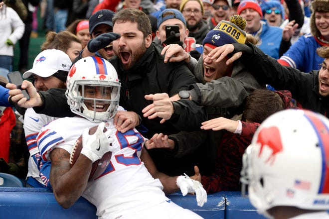Buffalo Bills wide receiver Isaiah McKenzie celebrates with fans after scoring a touchdown run against the Jacksonville Jaguars during the first half of an NFL football game, Sunday, Nov. 25, 2018, in Orchard Park, N.Y. (AP Photo/Adrian Kraus)