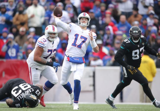 BUFFALO, NY - NOVEMBER 25: Josh Allen #17 of the Buffalo Bills throws a pass in the second quarter during NFL game action against the Jacksonville Jaguars at New Era Field on November 25, 2018 in Buffalo, New York. (Photo by Tom Szczerbowski/Getty Images)
